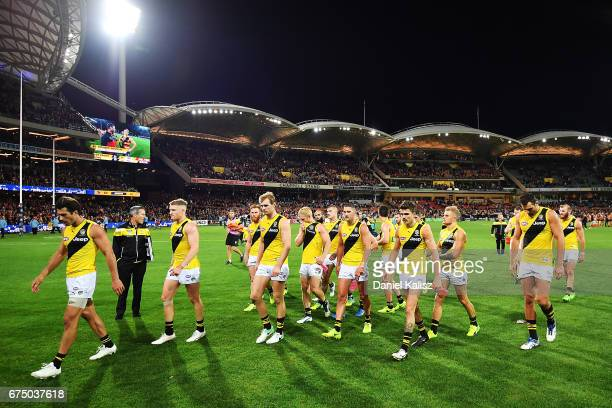 The Tigers players walk from the field after being defeated by the Crows during the round six AFL match between the Adelaide Crows and the Richmond...