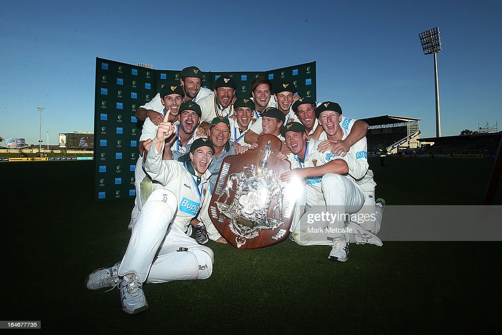 The Tigers pose with the Sheffield Shield trophy after winning the Sheffield Shield final between the Tasmania Tigers and the Queensland Bulls at Blundstone Arena on March 26, 2013 in Hobart, Australia.
