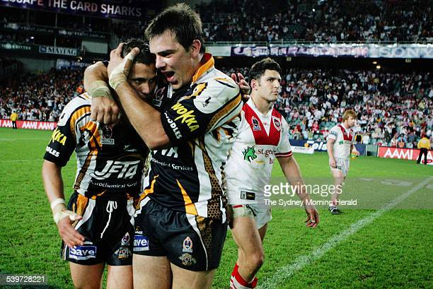 The Tigers' Scott Prince and John Skandalis hug at the end of the NRL rugby league semifinal match between the Wests Tigers and St GeorgeIllawarra...