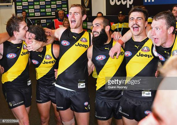The Tigers sing the song in the rooms after winning the round five AFL match between the Richmond Tigers and the Melbourne Demons at Melbourne...