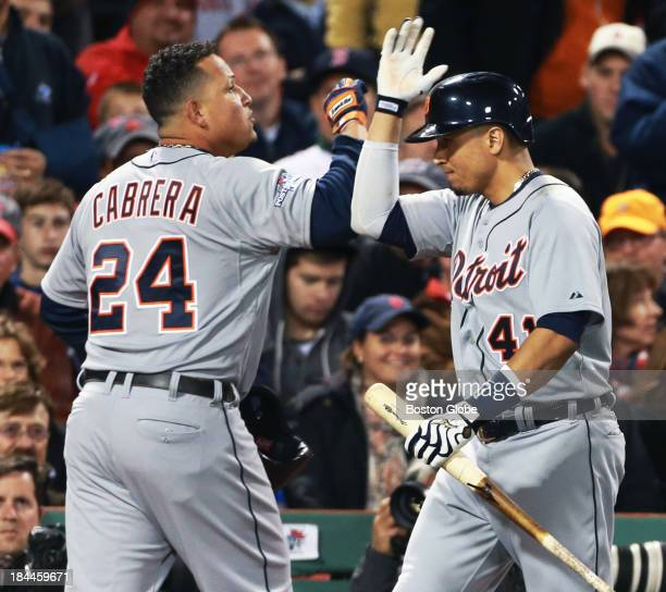 The Tigers' Victor Martinez right greets teammate Miguel Cabrera left following his sixth inning solo home run off of Red Sox starter Clay Buchholz...