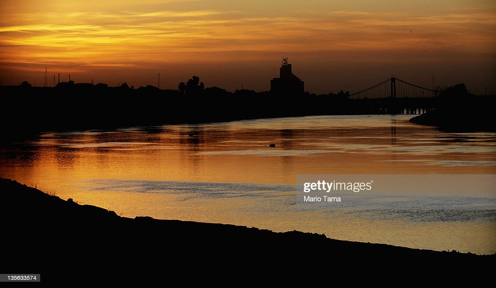 the Tigris River is seen at sunset on December 12, 2011 in Baghdad, Iraq. Iraq is transitioning nearly nine years after the 2003 U.S. invasion and subsequent occupation. American forces are now in the midst of the final stage of withdrawal from the war-torn country. At least 4,485 U.S. military personnel have died in service in Iraq. According to the Iraq Body Count, more than 100,000 Iraqi civilians have died from war-related violence.