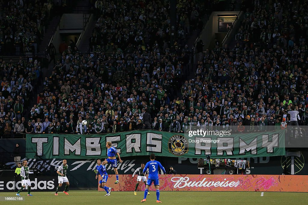 The Timbers Army supporters sing in the stands as the Portland Timbers face the San Jose Earthquakesat JELD-WEN Field on April 14, 2013 in Portland, Oregon. The Timbers defeated the Earthquakes 1-0.