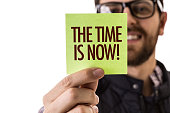 The Time is Now sign
