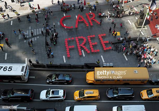 The Times Square Alliance shows off a street art display spelling out Car Free in street furniture in Times Square in New York on April 21 2016 as a...