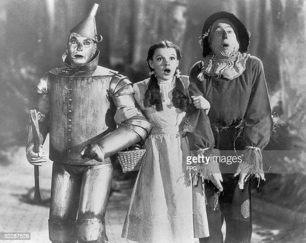 The Tin Man Dorothy and the Scarecrow set off on their quest for fulfillment in the children's classic 'The Wizard of Oz' directed by Victor Fleming...