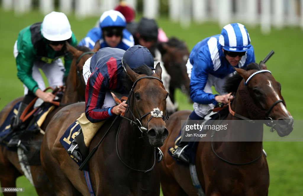 The Tin man ridden by Tom Queally(dark blue cap) wins the Diamond Jubilee Stakes on day 5 of Royal Ascot at Ascot Racecourse on June 24, 2017 in Ascot, England.