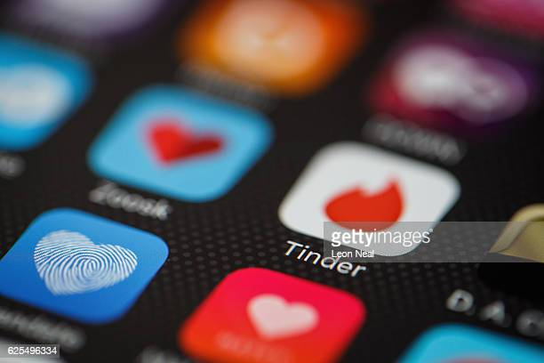The 'Tinder' app logo is seen amongst other dating apps on a mobile phone screen on November 24 2016 in London England Following a number of deaths...