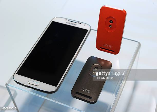 The Tinké connected health monitor by Zensorium is displayed beside an Android smartphone to which it can link via Bluetooth at 'CES Unveiled' the...