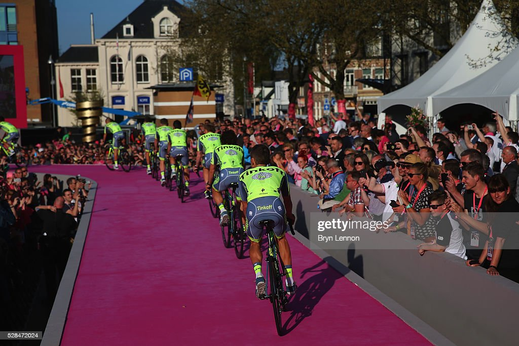 The Tinkoff team ride onto the stage during the Opening Ceremony and official Team Presentation for the 2016 Giro d'Italia at the City Hall on May 05, 2016 in Apeldoorn, Netherlands.