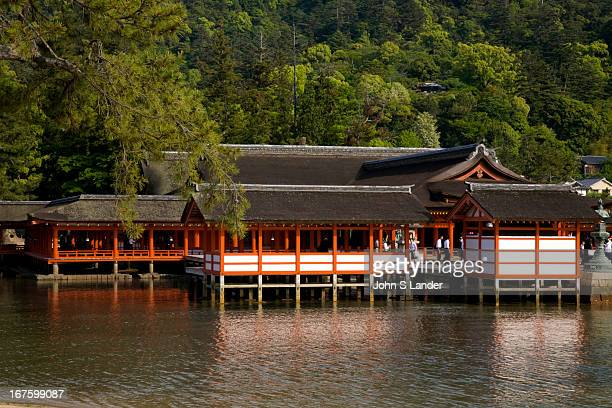 The tiny island of Miyajima is home to the world renowned Itsukushima Shrine a UNESCO World Heritage site At high tide the shrine is completely...