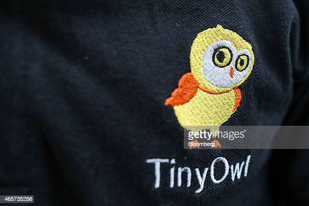 The Tiny Owl logo is displayed on the shirt of a food delivery employee at the company's head office in Mumbai India on Monday March 9 2015 Tiny Owl...