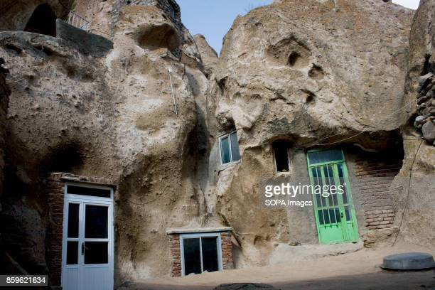 The tiny village of Kandovan in the Iranian East Azerbaijan Province is known for its cliff dwellings not built on the rock formations but carved...