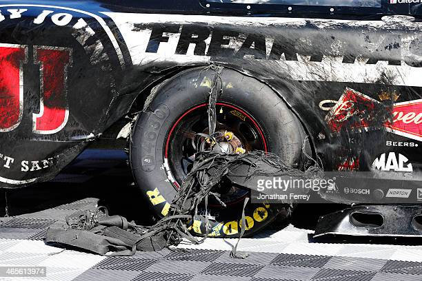 The tire of Kevin Harvick driver of the Jimmy John's/Budweiser Chevrolet is seen after he celebrated winning with a burnout during the NASCAR Sprint...