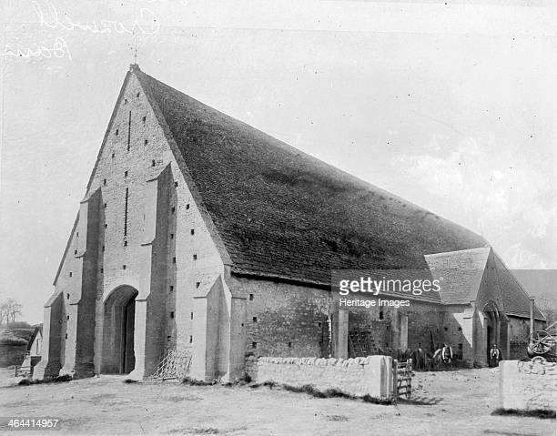 The Tithe or Abbey Barn Great Coxwell Oxfordshire c1900 with an engine visible in the yard It formed the centre of a grange at Beaulieu Abbey