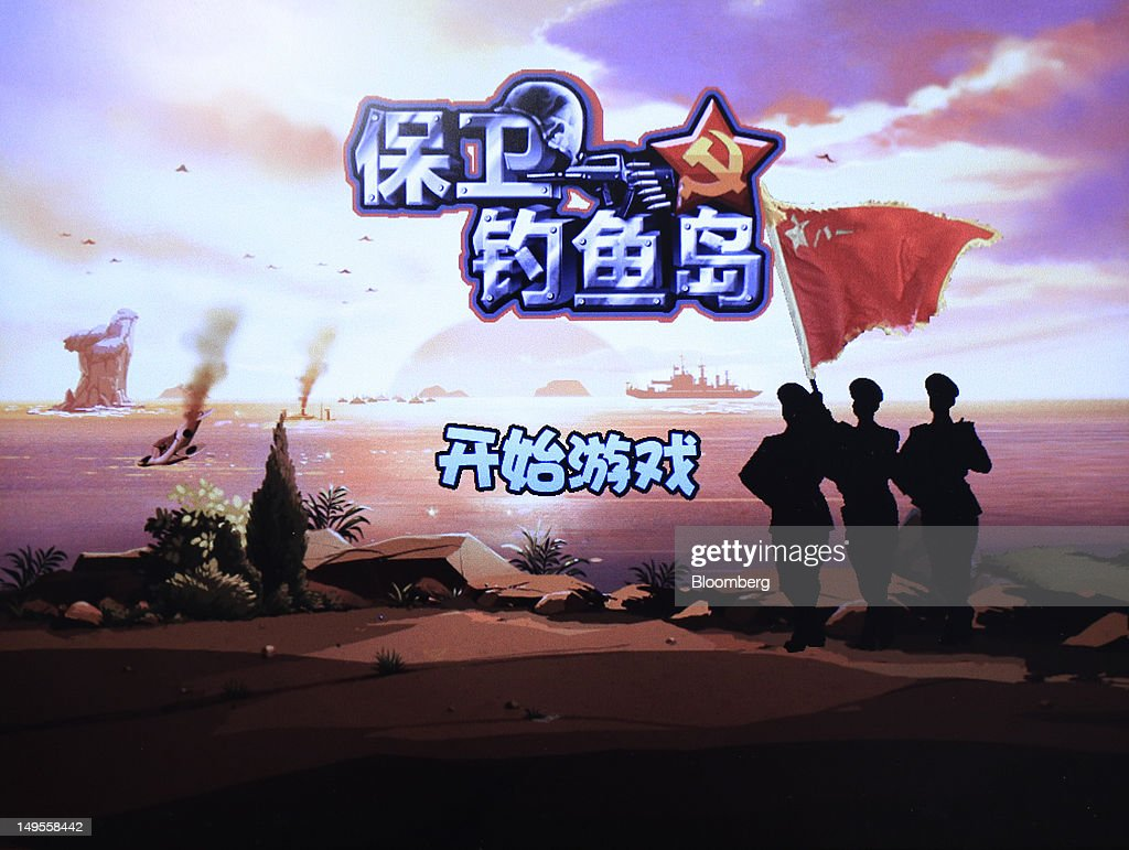 The title screen for Shenzhen Zhongqingbaowang Network Technology Co.'s Defend the Diaoyu Islands video game is displayed on a tablet computer in Beijing, China, on Friday, July 27, 2012. When China's Communist Youth League celebrated its 90th birthday, it employed a tactic unavailable to President Hu Jintao when he used the organization to propel his career: a microblog promotion. Photographer: Nelson Ching/Bloomberg via Getty Images