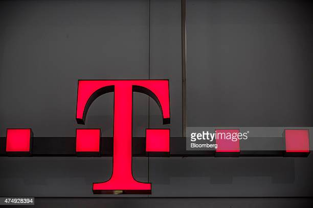 The TMobile logo for Deutsche Telekom AG's TSystems unit sits outside a Slovak Telekom AS mobile phone in Bratislava Slovakia on Wednesday May 27...