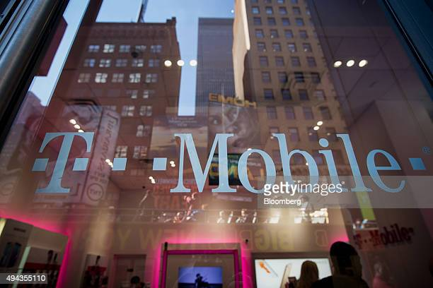 The TMobile US Inc logo is displayed on a door at a TMobile US Inc store in New York US on Monday Oct 26 2015 TMobile US Inc is scheduled to release...