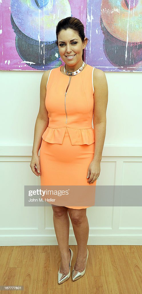 The 'Today Show's' style editor and fashion expert <a gi-track='captionPersonalityLinkClicked' href=/galleries/search?phrase=Bobbie+Thomas&family=editorial&specificpeople=797716 ng-click='$event.stopPropagation()'>Bobbie Thomas</a> signs copies of her new book 'The Power Of Style' at Georgetown Cupcakes in Los Angeles on April 29, 2013 in Los Angeles, California.