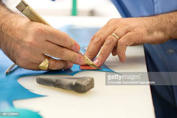 FIGARO ID 111370017 The Tod's factory is photographed for Le Figaro Magazine on July 29 2014 in Casette d'Ete Italy Cutting the leather CREDIT MUST...