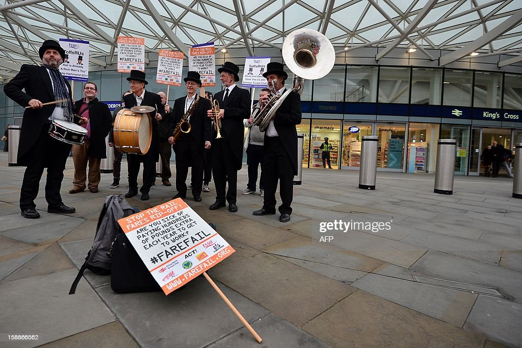 The 'ToffsRUs' jazz band play during a demonstration against a hike in rail fares at Kings Cross station in central London on January 2, 2013. Rail commuters were hit with an average 4.2% fare rise as an increase in season ticket rates announced in August 2012 came into effect. AFP PHOTO/BEN STANSALL
