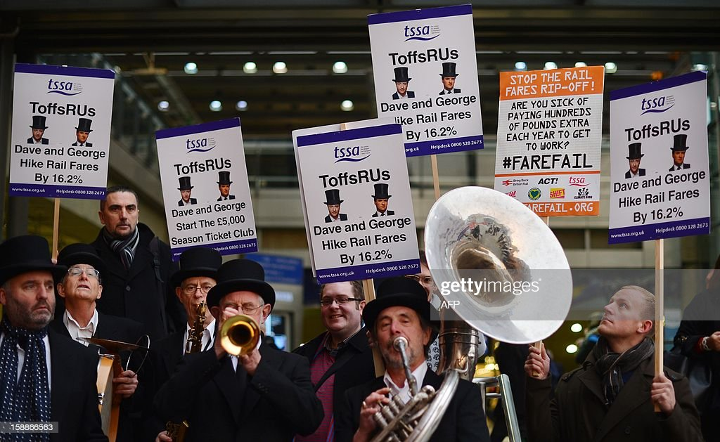 The 'ToffsRUs' jazz band play during a demonstration against a hike in rail fares at Kings Cross station in central London on January 2, 2013. Rail commuters were hit with an average 4.2% fare rise as an increase in season ticket rates announced in August 2012 came into effect.