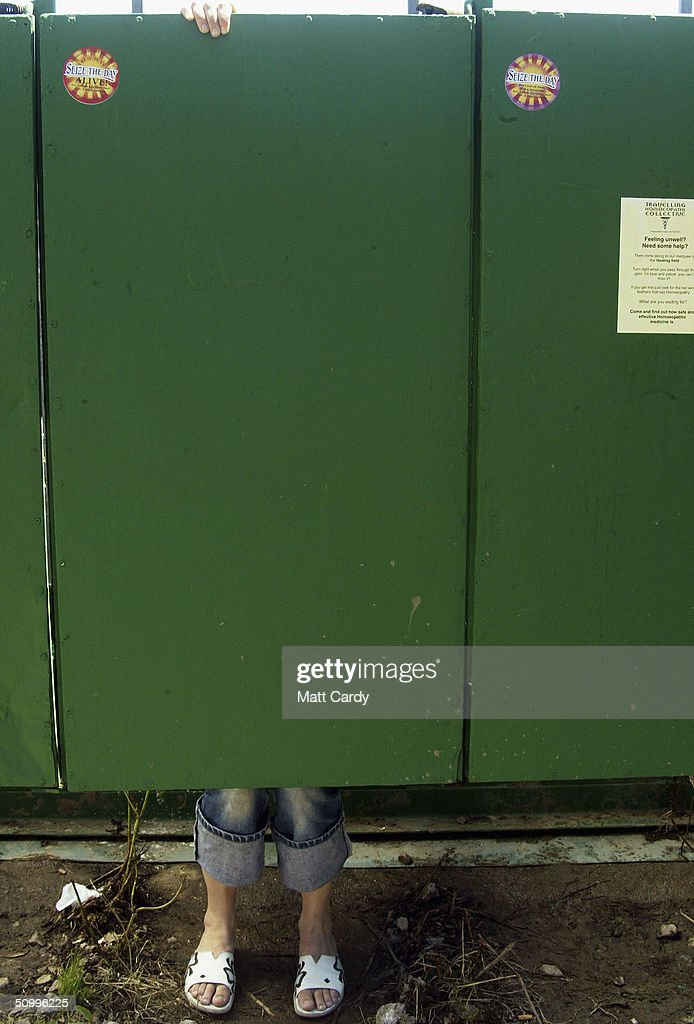 The toilet cubicles are seen being used, during the 2004 Glastonbury Festival on June 25, 2004 at Worthy Farm, Pilton, Somerset, England. The music festival spans over 3 days and runs until June 27.