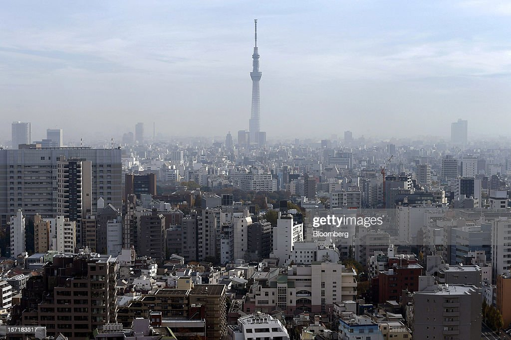 The Tokyo Sky Tree stands amid buildings in Tokyo, Japan, on Thursday, Nov. 29, 2012. Japan's cabinet approved a second round of fiscal stimulus worth 880 billion yen ($10.7 billion) using budget reserves as Prime Minister Yoshihiko Noda attempts to boost the economy before elections on Dec. 16. Photographer: Kiyoshi Ota/Bloomberg via Getty Images