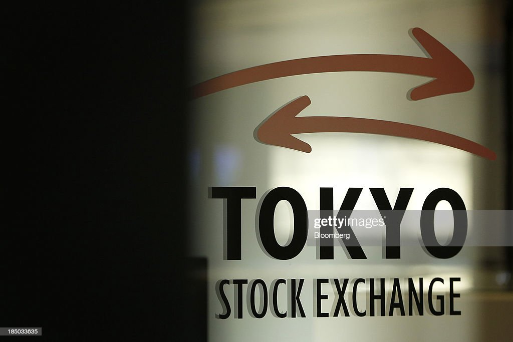 The Tokyo Stock Exchange (TSE) logo is displayed on a glass door at the bourse in Tokyo, Japan, on Thursday, Oct. 17, 2013. Japanese shares rose, with the Topix index climbing to a three-week high, after the U.S. Congress voted to end the government shutdown and raise the debt ceiling, ending the nation's fiscal impasse. Photographer: Kiyoshi Ota/Bloomberg via Getty Images