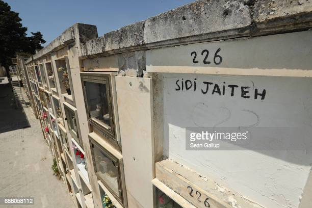 The tomb of someone identified as Sidi Jaiteh who according to the cemetery caretaker is a migrant who died while trying to reach Italy lies in a...
