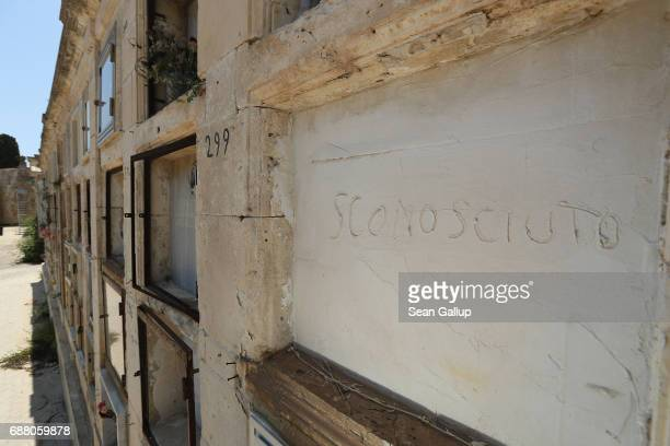 The tomb of someone identified only as 'unknown' who according to the cemetery caretaker is a migrant who died while trying to reach Italy lies in a...