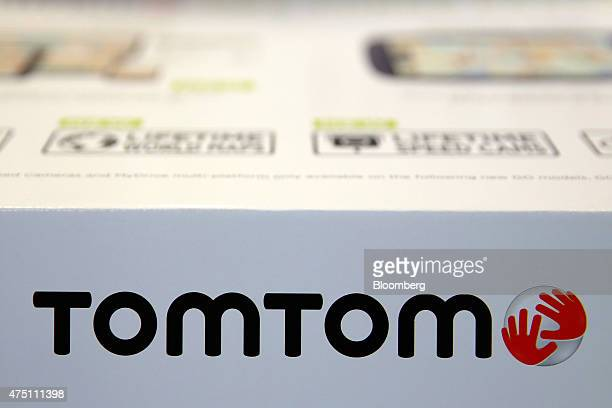 The TomTom logo sits on a box containing a satellite navigation system manufactured by TomTom NV on display inside a Halfords Group Plc store in...