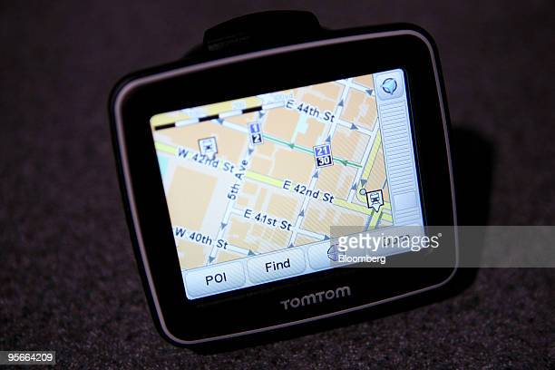 The TomTom NV Ease navigation system sits on display during the 2010 International Consumer Electronics Show in Las Vegas Nevada US on Friday Jan 8...