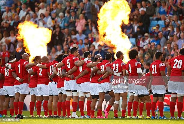 The Tonga team line up for the national anthems during the 2015 Rugby World Cup Pool C match between Tonga and Namibia at Sandy Park on September 29...
