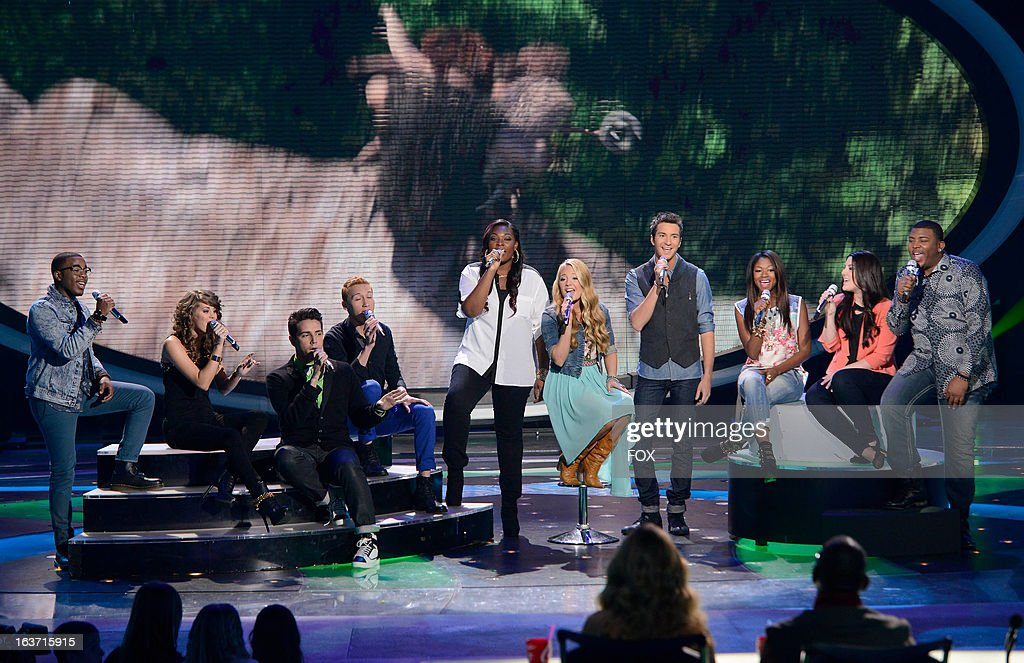 The top 10 contestants (L-R) Burnell Taylor, Angie Miller, Lazaro Arbos, Devin Velez, Candice Glover, Janelle Arthur, Paul Jolley, Amber Holcomb, Kree Harrison an Curtis Finch, Jr. perform onstage at FOX's 'American Idol' Season 12 Top 10 To 9 Live Elimination Show on March 14, 2013 in Hollywood, California.