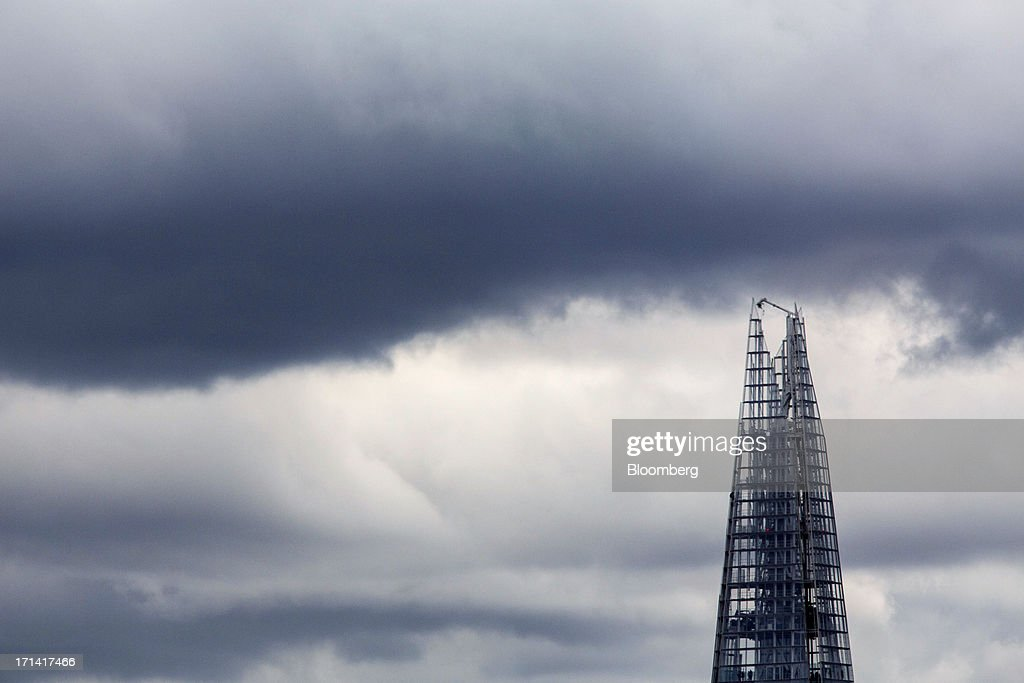 The top floors of the Shard tower are seen from the Swiss Re building, also known as the 'Gherkin', in London, U.K., on Sunday, June 23, 2013. U.K. commercial real estate values rose for the first time in 18 months in May, led by increasing demand for offices, Investment Property Databank Ltd. said. Photographer: Jason Alden/Bloomberg via Getty Images