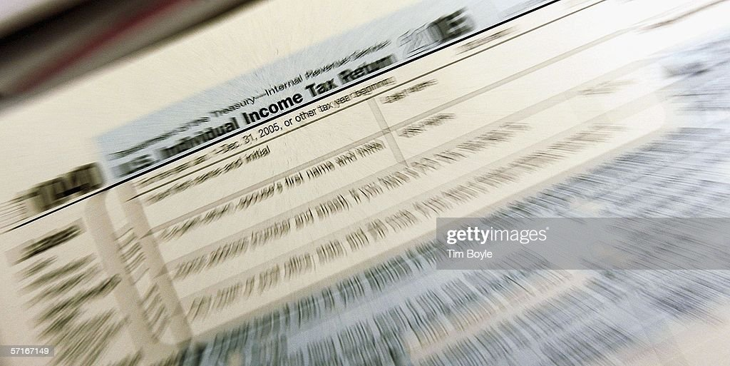 The top of a 1040 individual income tax return for 2005 is seen at the Des Plaines Public Library March 23, 2006 in Des Plaines, Illinois. As next month's income tax deadline approaches, Americans are preparing for it by using tax software, filing out paper forms or by using a tax preparer.