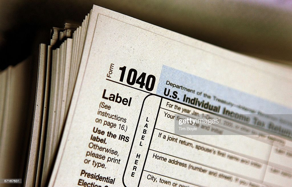 The top of a form 1040 individual income tax return for 2005 is seen atop a stack on the same at the Des Plaines Public Library March 23, 2006 in Des Plaines, Illinois. Americans are preparing for the income tax filing deadline next month whether using tax software, filing on the paper forms or using a tax preparer.