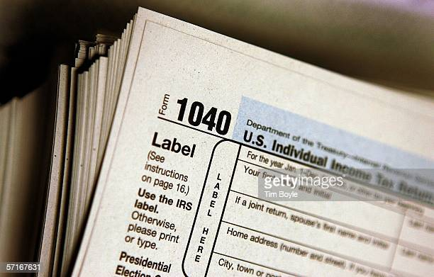 The top of a form 1040 individual income tax return for 2005 is seen atop a stack on the same at the Des Plaines Public Library March 23 2006 in Des...