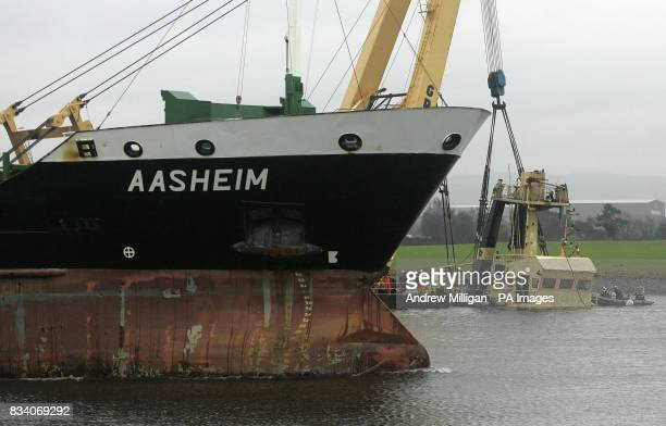 The top of the Flying Phantom tug is visible as the barge GPS Atlas continues its salvage operation on the river Clyde The Flying Phantom tug sank...