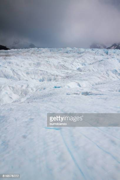 The top surface of Perito Moreno Glacier showing ice, erosion, crevasses and turquoise hues.