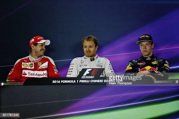 The top three drivers Nico Rosberg of Germany and Mercedes GP Sebastian Vettel of Germany and Ferrari and Daniil Kvyat of Russia and Red Bull Racing...