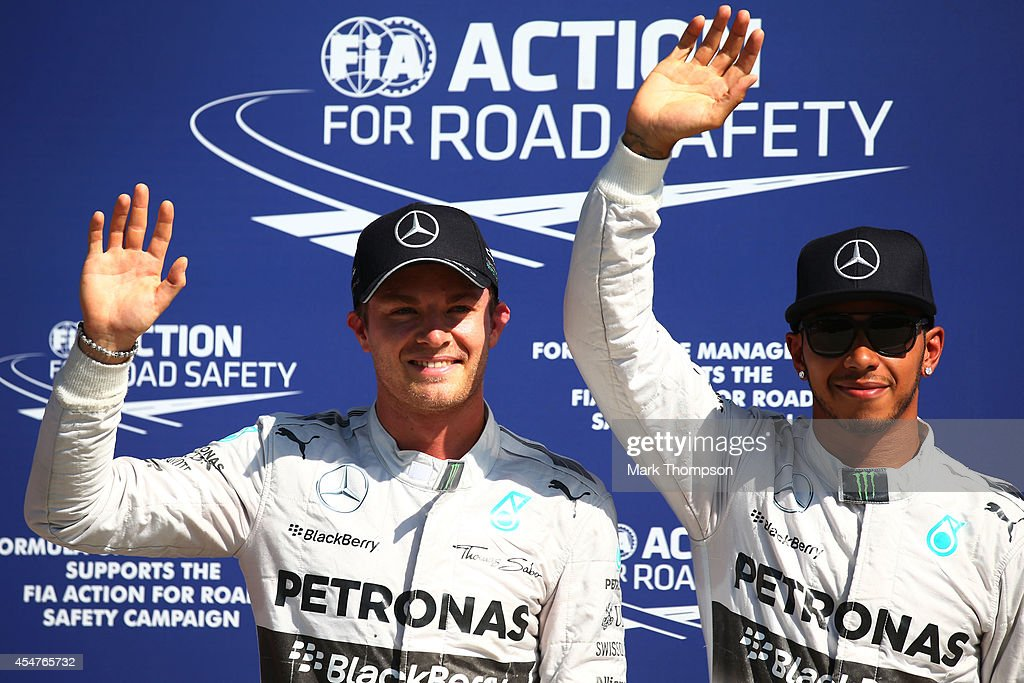 The top two qualifying drivers Nico Rosberg of Germany and Mercedes GP and Lewis Hamilton of Great Britain and Mercedes GP pose for the cameras...