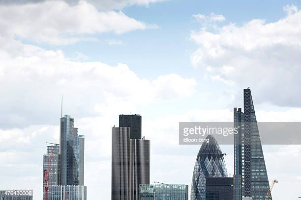 The tops of skyscrapers in the City of London financial district including 30 St Mary Axe also known as the 'Gherkin' and the Leadenhall building...