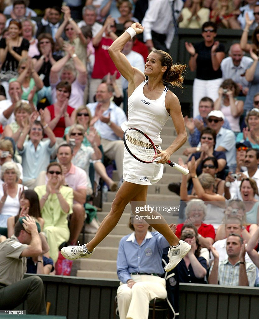 The top-seeded Amelie Mauresmo of France celebrating her defeat of former champion <a gi-track='captionPersonalityLinkClicked' href=/galleries/search?phrase=Maria+Sharapova&family=editorial&specificpeople=157600 ng-click='$event.stopPropagation()'>Maria Sharapova</a> of Russia in the semifinals of the 2006 Wimbledon Championships at the All England Lawn Tennis and Croquet Club in Wimbledon, Great Britain on July 6, 2006. Mauresmo won 6-3, 3-6, 6-2 to reach the ladies singles final against <a gi-track='captionPersonalityLinkClicked' href=/galleries/search?phrase=Justine+Henin&family=editorial&specificpeople=157479 ng-click='$event.stopPropagation()'>Justine Henin</a>-Hardenne.
