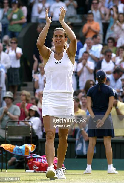 The topseeded Amelie Mauresmo of France celebrating her defeat of former champion Maria Sharapova of Russia in the semifinals of the 2006 Wimbledon...