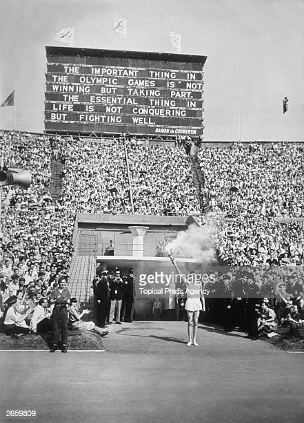 The Torch Bearer the last of the runners bringing the flame from Greece arrives at Wembley Stadium London during the opening ceremony of the 1948...