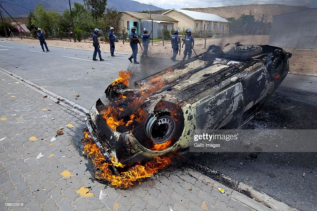 The torched car of a Times photographer in De Doorns, on January 9, 2013, in Cape Town, South Africa. The farm workers protest turned violent as farm workers demanded R150 wages per day.