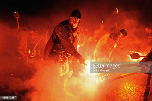 The torches of the Jarl Squad are lit as they march through the streets of Lerwick on January 28 in the Shetland Islands Scotland The traditional...