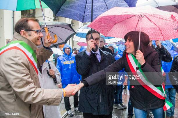 The Torino's mayor Chiara Appendino of Movimento 5 Stelle congratulate others authorities at the head of Workers Day parade in Turino Italy on 1st...